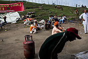 Hindu Pilgrims stop a campsite providing free food to pilgrims at the first pass, Pissu Top (11500ft) enroute to the pilgrimage to Amarnath in Kashmir, India. Hindu pilgrims brave sub zero temperature and high latitude passes and make their pilgrimage to reach the sacred Amarnath cave, which houses a lingam - a stylized phallus, worshiped by Hindus as a symbol of God Shiva. Photo: Sanjit Das/Panos