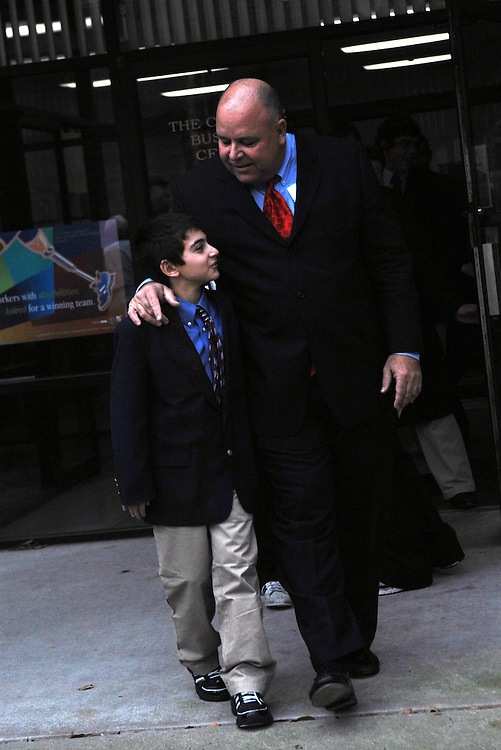 E.J. Pipkin leaves the Chamber of Commerce in Salisbury, Maryland, with his son Tyler, 11, after announcing his candidacy for Maryland's 1st District Congressional seat
