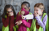 NWA Democrat-Gazette/DAVID GOTTSCHALK Clara Culpepper (right), a second grade student in Chad Lechtenberger's class at Washington Elementary School, covers her nose Monday, May 13, 2019, with classmates as they stand in the Trasfer Station during a tour in Fayetteville. The students toured the city of Fayetteville Transfer Station and Material Recovery Facility as part of unit studying natural resources and recycling environmental issues.