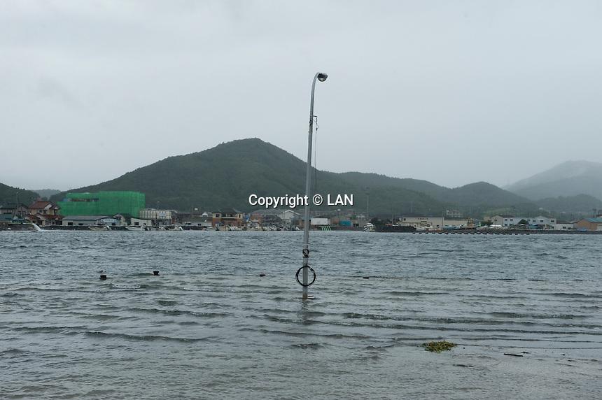 Landscape view of damaged buildings on Mangokuura Sea following the 311 Tohoku Tsunami in Onagawa, Japan  © LAN