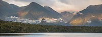 Sunrise over Lake Manapouri with rainbow and Monument, Fiordland National Park, UNESCO World Heritage Area, Southland, New Zealand, NZ