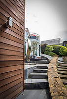 BNPS.co.uk (01202 558833)<br /> Pic: MrAndMrsClarke/BNPS<br /> <br /> A modern staircase runs alongside the original garden steps.  <br /> <br /> A luxury house on an English country estate where the Allies plotted the infamous assassination of one of Adolf Hitler's top henchmen has gone on the market.<br /> <br /> Rooftops, a Norwegian-style chalet, is located on the Moreton Paddox estate in Warwickshire where 4,000 Czech soldiers were billeted during the Second World War.<br /> <br /> The plot to assasinate Nazi monster SS General Reinhard Heydrich involved two Czech soldiers who parachuted into Prague where they attacked and killed him as he was driven to work. <br /> <br /> His death led to appalling Nazi reprisals on locals, with more than 1,300 men, women and children massacred.<br /> <br /> The Edwardian mansion at Moreton Paddox that was requisitioned for the war effort was later demolished and Rooftops was built on the grounds in 2009.