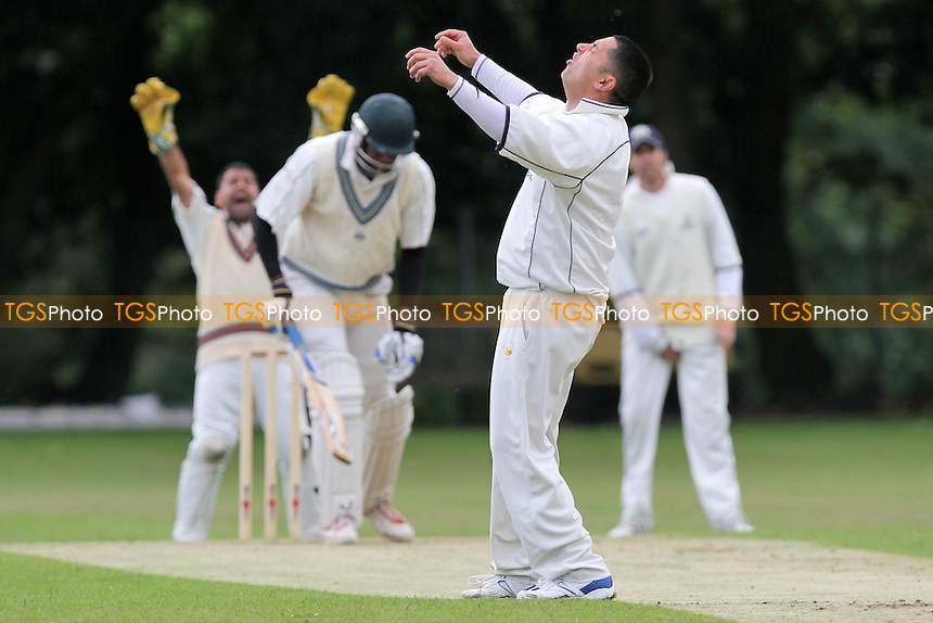 Shahid Saeed of Wanstead goes close to the wicket of Andrew Richardson - Wanstead CC (fielding) vs Woodford Wells CC - Essex Cricket League - 18/06/11 - MANDATORY CREDIT: Gavin Ellis/TGSPHOTO - Self billing applies where appropriate - Tel: 0845 094 6026