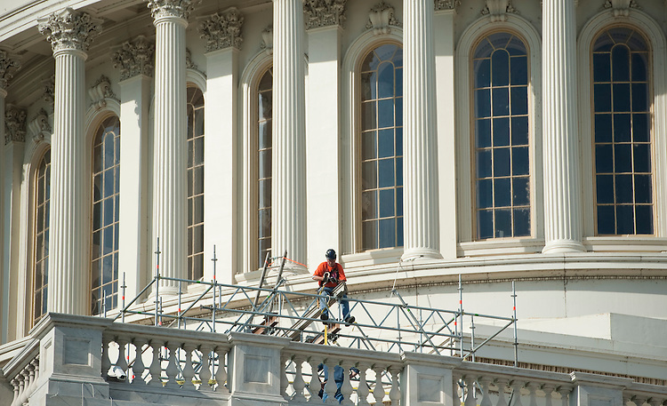 UNITED STATES – NOVEMBER 14: Workers begin setting up scaffolding around the base of the U.S. Capitol dome on Monday, Nov. 14, 2011. Workers are beginning the restoration of the Capitol Dome skirt – the lower level of the cast iron Dome. (Photo By Bill Clark/CQ Roll Call)