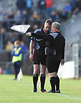Referee Wayne King has a word with his linesman during the county senior hurling final at Cusack Park. Photograph by John Kelly.