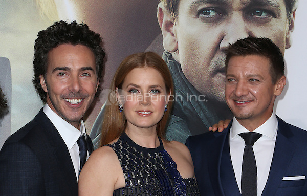 """Westwood, CA - NOVEMBER 06: Shawn Levy, Amy Adams, Jeremy Renner at Premiere Of Paramount Pictures' """"Arrival"""" At Regency Village Theatre, California on November 06, 2016. Credit: Faye Sadou/MediaPunch"""