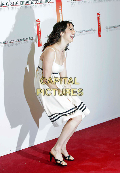 "RACHEL WEISZ.""The Constant Gardener"" premieres at the 62nd Annual Venice Film Festival, Venice, Italy..September 9th, 2005.Photo Credit: Bedrosien/Siemoenit/Admedia.full length white dress stripes windy laughing .www.capitalpictures.com.sales@capitalpictures.com.© Capital Pictures."