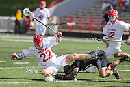 College Park, MD - May 14, 2017: Maryland Terrapins Wesley Janeck (22) gets knocked down during the NCAA first round game between Bryant and Maryland at  Capital One Field at Maryland Stadium in College Park, MD.  (Photo by Elliott Brown/Media Images International)