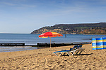 Deck chairs and sun loungers on Sandown beach, Isle of Wight, on a sunny morning.