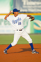 Shortstop Adrian Martinez #18 of the Burlington Royals makes a throw to first base against the Bristol White Sox at Burlington Athletic Stadium August 13, 2010, in Burlington, North Carolina.  Photo by Brian Westerholt / Four Seam Images