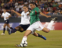 Carli Lloyd of USA (L) and Natalie Vinti of Mexico (R) during the semifinal match of CONCACAF Women's World Cup Qualifying tournament held at Estadio Quintana Roo in Cancun, Mexico. Mexico 2, USA 1.