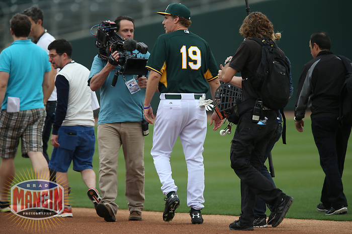 MESA, AZ - MARCH 12:  Actor Will Ferrell of the Oakland Athletics warms up before a spring training game against the Seattle Mariners at HoHoKam Stadium on March 12, 2015 in Mesa, Arizona. (Photo by Brad Mangin)