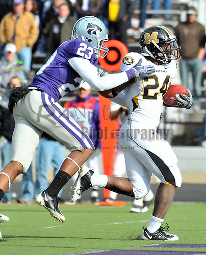 Nov 14, 2009; Manhattan, KS, USA; Missouri running back Derrick Washington (24) does in for a touchdown as Kansas State defensive back Emmanuel Lamur (23) attempts the tackle in the third quarter at Bill Snyder Family Stadium. The Tigers won 38-12. Mandatory Credit: Denny Medley-US PRESSWIRE
