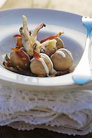 Europe/Italie/Vénétie/Dolomites/Cortina d'Ampezzo:  Gnocchi de pommes de terrre  et noix farci de fromage taleggio et de speck recette de Graziamo Pest  chef du restaurant Tivoli