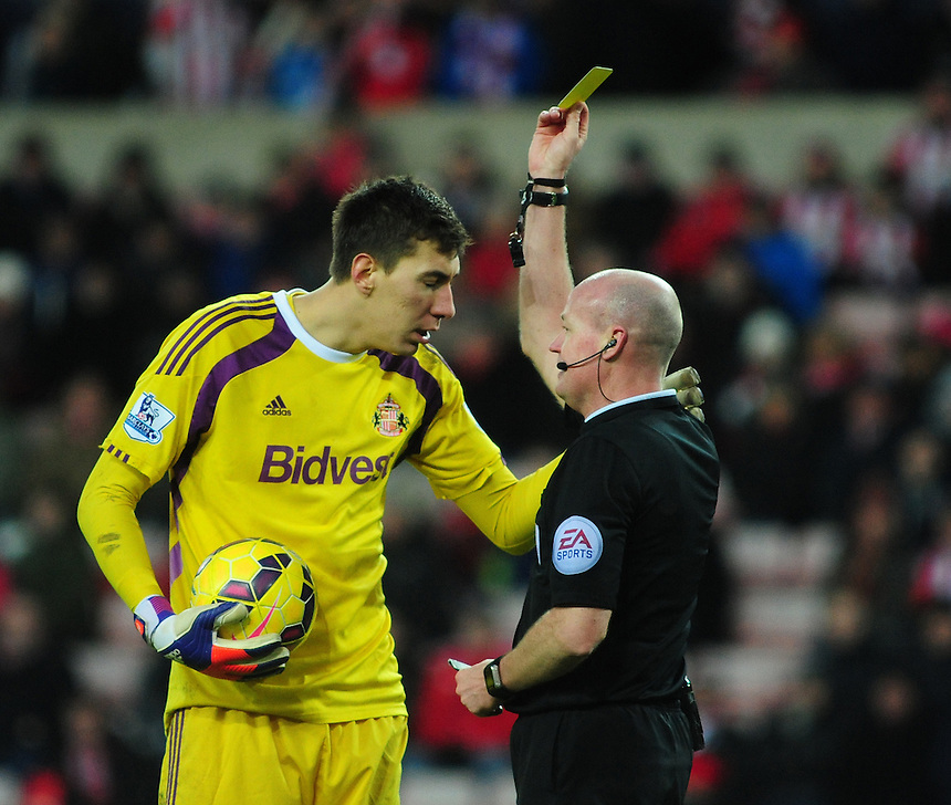 Sunderland's Costel Pantilimon is shown a yellow card by Referee Lee Mason<br /> <br /> Photographer Chris Vaughan/CameraSport<br /> <br /> Football - Barclays Premiership - Sunderland v Burnley - Saturday 31st January 2015 - Stadium of Light - Sunderland<br /> <br /> &copy; CameraSport - 43 Linden Ave. Countesthorpe. Leicester. England. LE8 5PG - Tel: +44 (0) 116 277 4147 - admin@camerasport.com - www.camerasport.com