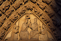 Upper lintel depicting Mary in Heaven, seated on the same throne as Jesus and crowned by an angel while Jesus blesses her and gives her a sceptre, Portal of the Virgin, 1210 - 1220, Notre Dame de Paris, 1163 ? 1345, initiated by the bishop Maurice de Sully, Ile de la Cité, Paris, France. Picture by Manuel Cohen