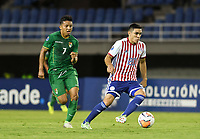 PEREIRA - COLOMBIA, 22-01-2020: Hugo Fernandez de Paraguay disputa el balón con John Garcia de Bolivia durante partido entre Paraguay y Bolivia por la fecha 2, grupo B, del CONMEBOL Preolímpico Colombia 2020 jugado en el estadio Hernan Ramirez Villegas en Pereira, Colombia. / Hugo Fernandez of Paraguay fights the ball with John Garcia of Bolivia during the match between Paraguay and Bolivia for the date 2, group B, for the CONMEBOL Pre-Olympic Tournament Colombia 2020 played at Hernan Ramirez Villegas stadium in Pereira, Colombia. Photo: VizzorImage / Julian Medina / Cont