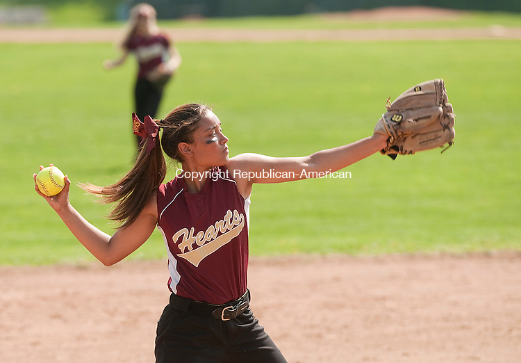 WATERBURY, CT--050815JS02-  Sacred Heart's Leilani Morales (1) throws to first after fielding a found ball during their game against Holy Cross Friday at Holy Cross High School in Waterbury. <br /> Jim Shannon Republican-American