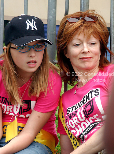 """Francesca Ruth Eastwood, left, and her mother, actress Frances Fisher, right, listen to the speakers at the """"March for Women's Lives"""" in Washington, DC on April 25, 2004..Credit: Ron Sachs / CNP"""
