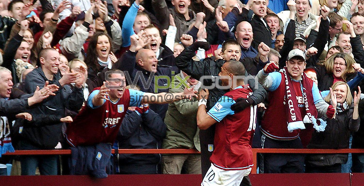 PICTURE BY Will Johnston/SWPIX.COM - Premier league football, Aston Villa v Birmingham City....20/04/08. Copyright - Simon Wilkinson - 07811267706...Aston Villa's John Carew celebrates with ball boy and fans