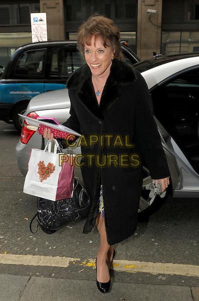 Esther Rantzen at BBC Radio 2, London, London, England.11th April, 2012.full length black coat bag purse takeaway pret a manger.CAP/IA.©Ian Allis/Capital Pictures.