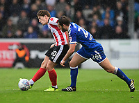 Lincoln City's Alex Woodyard vies for possession with Chesterfield's Jak McCourt<br /> <br /> Photographer Chris Vaughan/CameraSport<br /> <br /> The EFL Sky Bet League Two - Lincoln City v Chesterfield - Saturday 7th October 2017 - Sincil Bank - Lincoln<br /> <br /> World Copyright &copy; 2017 CameraSport. All rights reserved. 43 Linden Ave. Countesthorpe. Leicester. England. LE8 5PG - Tel: +44 (0) 116 277 4147 - admin@camerasport.com - www.camerasport.com