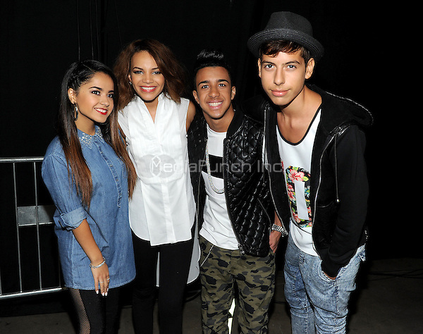 SAN ANTONIO, TX - AUGUST 31: (L-R) Becky G, Leslie Grace, Miguelito, and Matt Hunter   backstage at the 2014 People en Espanol Festival at the Henry B. Gonzalez Convention Center on August 31, 2014 in San Antonio, Texas. FMPG/MediaPunch
