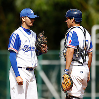21 June 2011: Quentin Becquey of Team France talks to Boris Marche as he pitches against UCLA Alumni during UCLA Alumni 5-3 win over France, at the 2011 Prague Baseball Week, in Prague, Czech Republic.