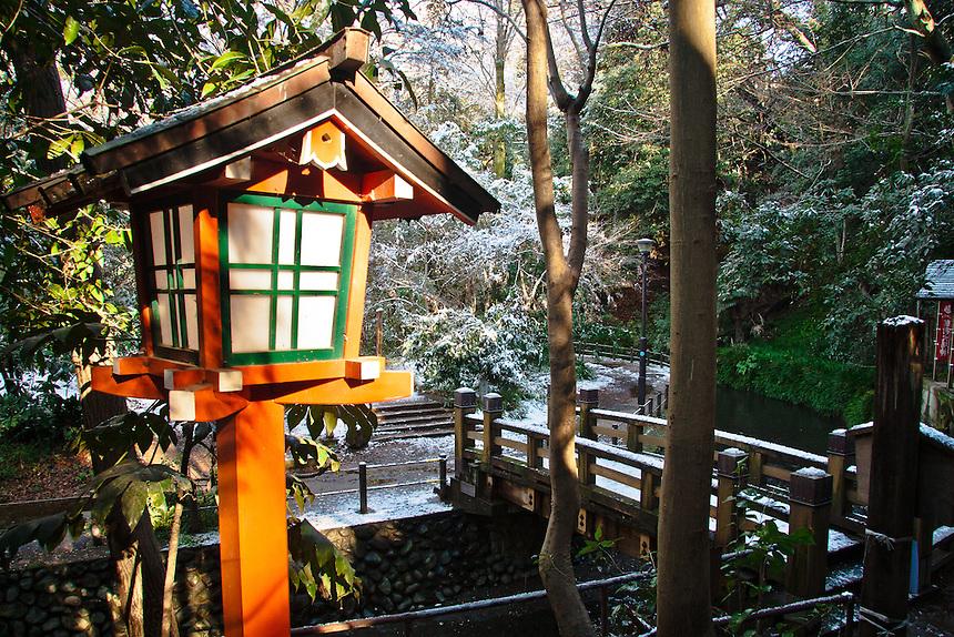 Todoroki Valley`s Fudo Buddhist temple in snow.