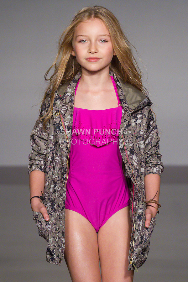 Model walks runway in an outfit from the Jessica Simpson children's wear collection, at the petitePARADE Spring 2016 fashion show.