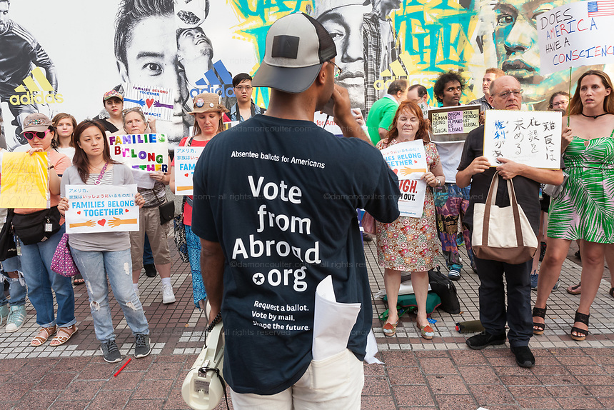 Activist Gordon Gaul talks to people as they take part in the families Belong Together Rally to protest the policy of separating migrant families as they cross the Southern US border carried out by the Administration of President Donald Trump in Tokyo's iconic Hachiko Square in Shibuya, Japan. Saturday June 30th 2018. Around thirty people from Democrats Abroad Japan, along with Japanese and other foreigners, took part in the demo which was part of an international day of action that saw more than 625 protests worldwide.