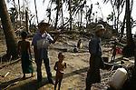 Cyclone Nargis survivors stand in the village of Kamingo, at the Irrawaddy Division, May 10, 2008. Despairing survivors in Myanmar awaited emergency relief on Friday, a week after 100,000 people were feared killed as the cyclone roared across the farms and villages of the low-lying Irrawaddy delta region. The storm is the most devastating one to hit Asia since 1991, when 143,000 people were killed in neighboring Bangladesh. Photo by Eyal Warshavsky  *** Local Caption *** ëì äæëåéåú ùîåøåú ìàéì åøùáñ÷é àéï ìòùåú áúîåðåú ùéîåù ììà àéùåø