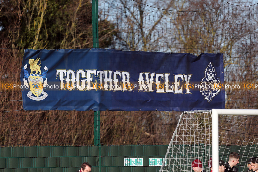A Together Aveley banner behind one of the goals during Aveley vs Chelmsford City, Buildbase FA Trophy Football at Parkside on 8th February 2020