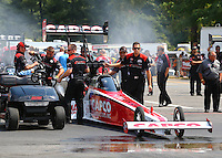 Aug. 2, 2014; Kent, WA, USA; Crew members with NHRA top fuel dragster driver Steve Torrence during qualifying for the Northwest Nationals at Pacific Raceways. Mandatory Credit: Mark J. Rebilas-