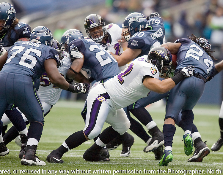 Seattle Seahawks running back Marshawn Lynch is tackled for a loss by Baltimore Ravens defensive tackle Haloti Ngata at  CenturyLink Field in Seattle, Washington on November 13, 2011. The Redskins beat the Seahawks 23-17 . ©2011 Jim Bryant Photo. All Rights Reserved.