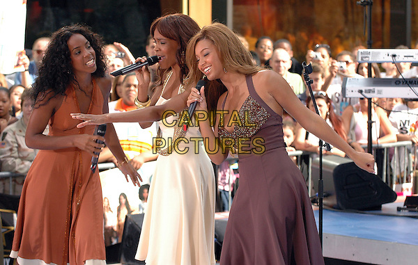 KELLY ROWLAND, MICHELLE WILLIAMS & BEYONCE KNOWLES - DESTINY'S CHILD.Performing in concert at the NBC Today Show at Rockefeller Center in Manhattan, New York, New York..July 29th, 2005.Photo Credit: Patti Ouderkirk/AdMedia.half length singing stage concert live gig performance white orange brown purple dress .www.capitalpictures.com.sales@capitalpictures.com.© Capital Pictures.