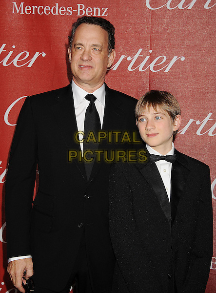 Tom Hanks & Thomas Horn.The 2012 Palm Springs Film Festival Awards Gala at the Palm Springs Convention Center in Palm Springs, California, USA..January 7th, 2012.half length black suit white shirt tuxedo  .CAP/ROT/TM.©Tony Michaels/Roth Stock/Capital Pictures