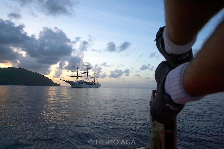 Caribbean cruise with Sea Cloud II. Anchoring at Man O'War Bay, Charlotteville, Tobago. Tender returning at sunset.