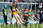 Donal Hunt Crotta O'Neills in action against Adam Maunsell Abbeydorney/Tralee Parnells in the Minor Hurling County Final   at Austin Stack Park on Sunday.