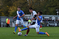 Alex Jones of Grimsby Town is denied by Wes Atkinson of Eastleigh during the Vanarama National League match between Eastleigh and Grimsby Town at The Silverlake Stadium, Eastleigh, Hampshire on Nov 21, 2015. (Photo: Paul Paxford/PRiME)