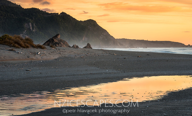 Sunset with reflections on beach near Punakaiki, Paparoa National Park, Buller Region, West Coast, New Zealand, NZ