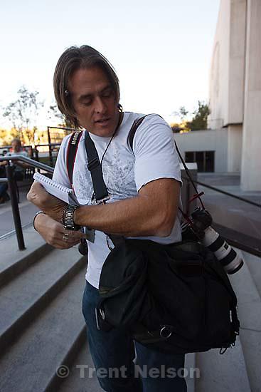 Keith Johnson with his camera bag.