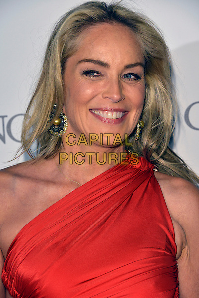 Sharon Stone. 'De Grisogono' party arrivals at the Eden Roc, Hotel du Cap, Antibes during the 66th  Cannes Film Festival, France 21st May 2013.headshot portrait red one shoulder smiling dangling gold earrings.CAP/PL.©Phil Loftus/Capital Pictures.