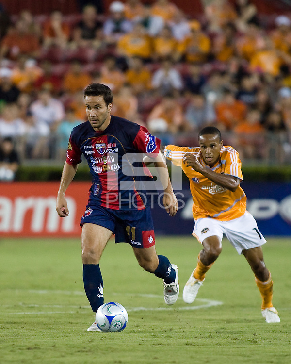 Atlante FC forward Luis Gabriel Rey dribbles away from Houston Dynamo midfielder Ricardo Clark.  Houston Dynamo leads Atlante FC 3-0 at halftime during the group stage of the Superliga tournament at Robertson Stadium in Houston, TX on July 12, 2008.