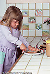 girl 3 1/2 years old  independece: making own sandwich (peanut butter)