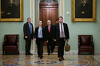 United States Senate Majority Leader Mitch McConnell (Republican of Kentucky) walks to the Senate floor as he arrives to the United States Capitol in Washington D.C., U.S. on Wednesday, March 25, 2020.  The Senate is set to vote on a Coronavirus Stimulus Package after working late into the night on Tuesday to finalize a two trillion dollar deal.  Credit: Stefani Reynolds / CNP/AdMedia