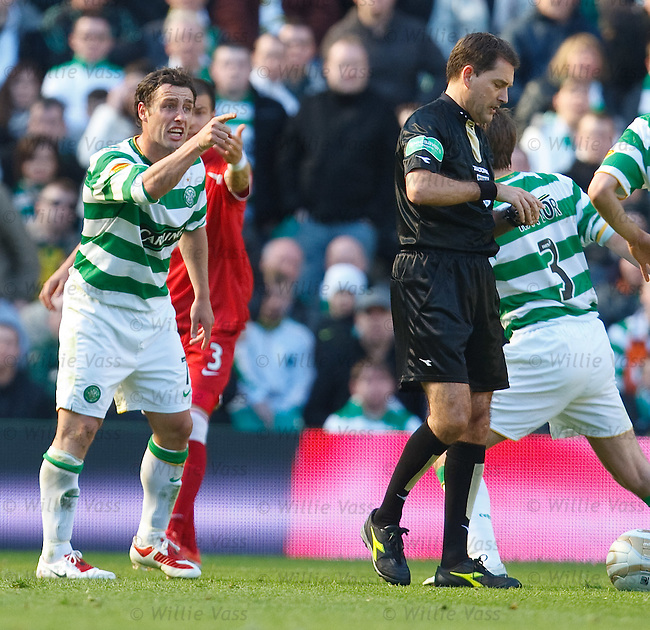 Scott McDonald continues his dissent at referee Dougie McDonald after he is cautioned