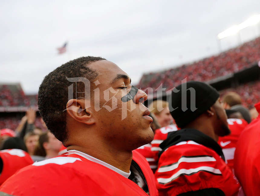 A tear runs down the check of senior Ohio State Buckeyes wide receiver Evan Spencer (6) following the NCAA football game against Michigan at Ohio Stadium on Saturday, November 29, 2014. (Columbus Dispatch photo by Jonathan Quilter)