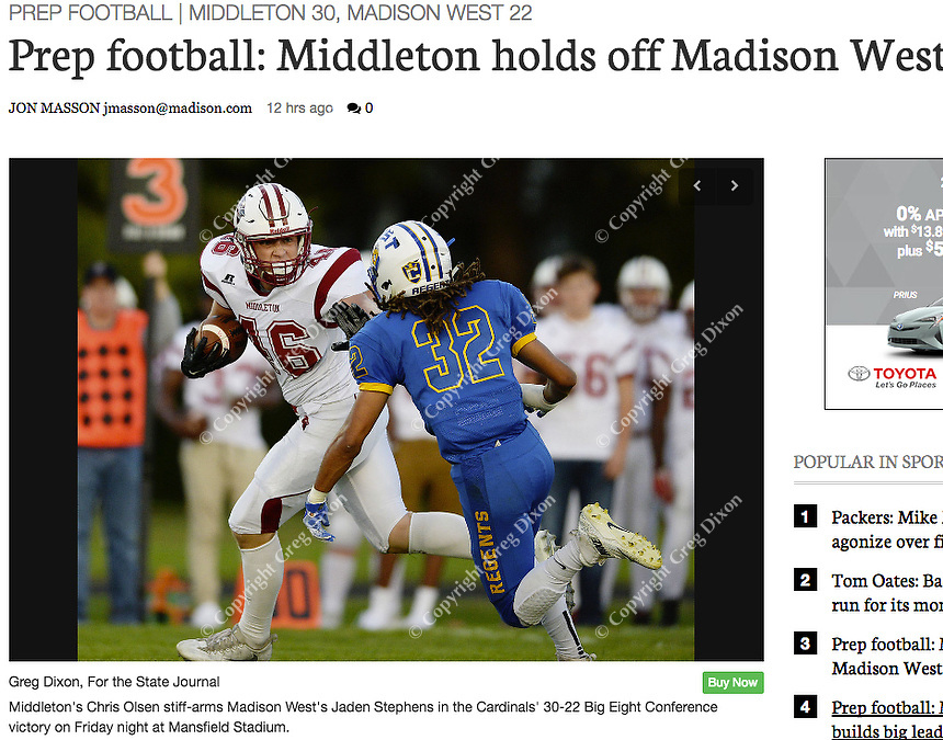 Middleton's Chris Olsen stiff-arms West's Jaden Stephens, as Middleton takes on Madison West in Big Eight Conference boys high school football at Mansfield Stadium on Friday, September 2, 2016, in Madison, Wisconsin | Wisconsin State Journal Sports page 9/3/16 and online at http://host.madison.com/wsj/sports/high-school/football/prep-football-middleton-holds-off-madison-west/article_6a0854b8-5f49-56a8-91b9-e21a324d9bdc.html