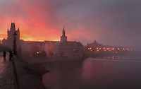 Sunrise at the Charles Bridge or Karluv most, built 1357 - 15th century, looking towards the Old Town bridge tower, the Vltava river and the Bedrich Smetana Museum in Prague, Czech Republic. The bridge's construction began under King Charles IV, replacing the old Judith Bridge built 1158'??1172 after flood damage in 1342. This new bridge was originally called the Stone Bridge (Kamenny most) or the Prague Bridge (Prazsky most) but has been the Charles Bridge since 1870. The bridge is 621m long and nearly 10m wide, resting on 16 arches shielded by ice guards. It is protected by three bridge towers, two on the Lesser Quarter side and one on the Old Town side. The historic centre of Prague was declared a UNESCO World Heritage Site in 1992. Picture by Manuel Cohen